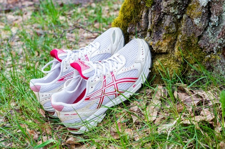 Asics sport shoes left on the tree Editorial