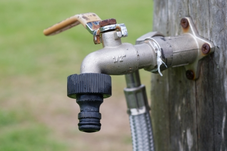 seeping: Old tap in the garden without water Stock Photo