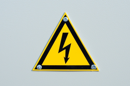 electroshock: High voltage sign on white metal plate Stock Photo
