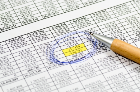 A table with the figures of revenue and expenditure Stock Photo