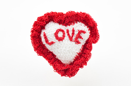 fervour: handmade heart knitted made from yarn and with word love Stock Photo