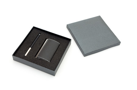Visit card holder and pen in gift box photo