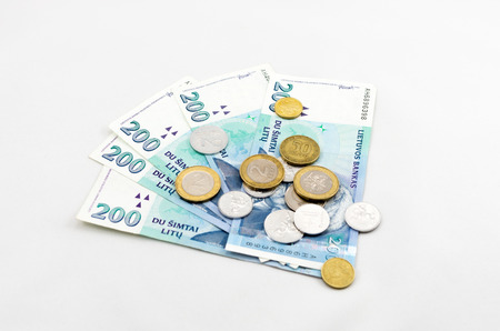 minimum wage: The minimum wage in Lithuania  Several banknotes and coins  Stock Photo