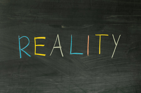 Reality word handwritten on the school blackboard