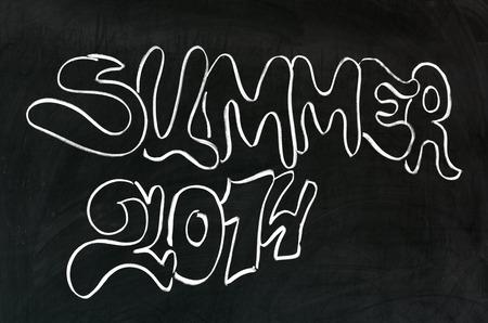 Summer 2014 handwritten on blackboard  Graffiti style  photo