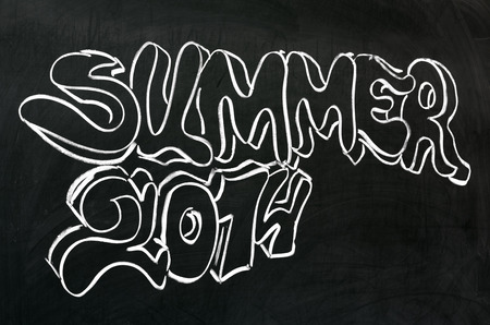 Summer 2014 handwritten on blackboard  Graffiti style  photo