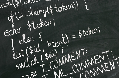 explained: A detail of computer code in PHP explained with white chalk