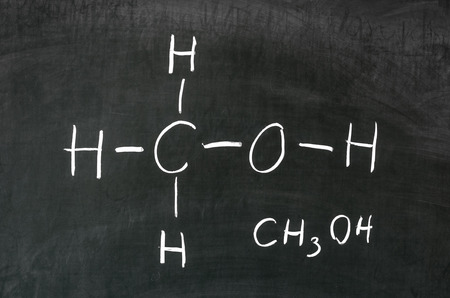 Alcohol methanol on blackboard in chemistry class  photo