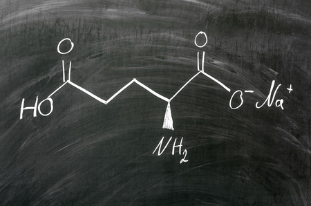 glutamate: Molecule structure of Monosodium glutamate written on blackboard Stock Photo