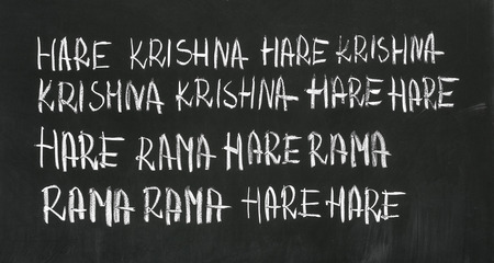 veda: The Hare Krishna mantra (Maha Mantra, Great Mantra) on the blackboard. Stock Photo