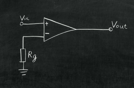 Operational amplifier circuit drawn on the blackboard with chalk photo