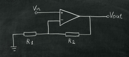 operational: Operational amplifier circuit drawn on the blackboard with chalk Stock Photo