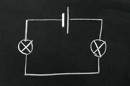 The electrical diagram drawn on a blackboard with chalk photo