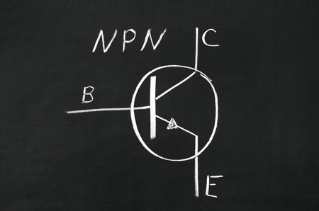 NPN type transistor marking sign drawed on the blackboard photo