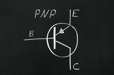 drawed: PNP type transistor marking sign drawed on the blackboard Stock Photo
