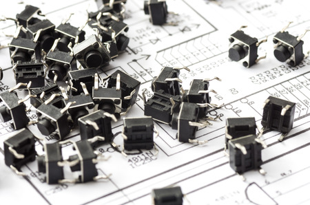 A lot of micro buttons placed on the drawing with the electric scheme photo