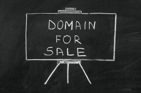 Domain for sale writed on blackboard with chalk photo