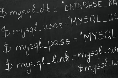 code computer: Un detalle de c�digo inform�tico en PHP explic� con tiza blanca