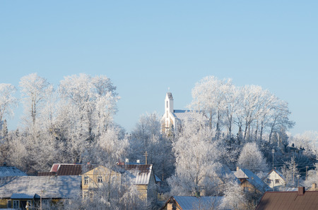 bilding: Cold winter. Frosted town in Lithuania. Zemaiciu Kalvarija Stock Photo