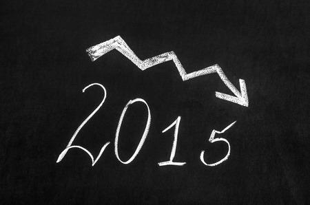 pessimistic: Pessimistic 2015 year graph drawn on the blackboard.