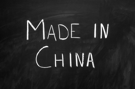 made in china: Made in China message handwritten on the blackboard
