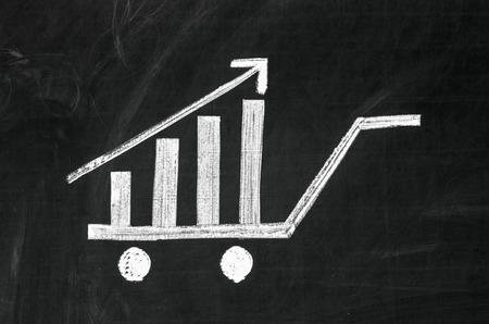 shown: Shopping cart is shown as growing graph Stock Photo