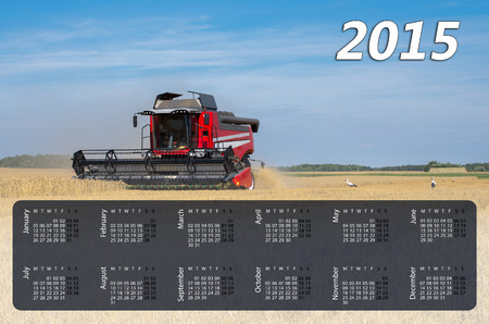 Calendar for 2015. Harvesting combine at the rye field photo