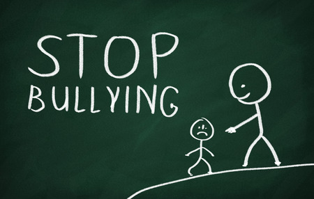 social emotional: On the blackboard draw character and write Stop bullying Stock Photo