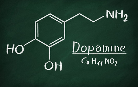 neurotransmitter: Chemical formula of Dopamine on a blackboard Stock Photo