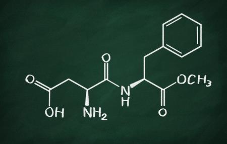 aspartame: Chemical formula of Aspartame on a blackboard Stock Photo