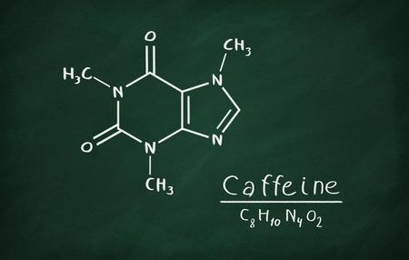 caffeine: Chemical formula of Caffeine on a blackboard Stock Photo