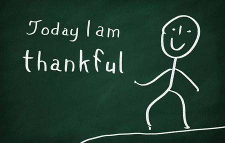 On the blackboard draw character and write Today I am thankful