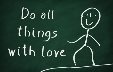 mindfulness: On the blackboard draw character and write Do all things with love Stock Photo