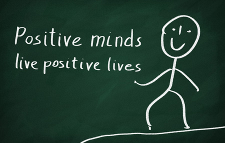 On the blackboard draw character and write Positive minds live positive lives