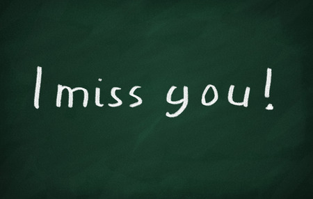 i miss you: On the blackboard with chalk write I miss you Stock Photo