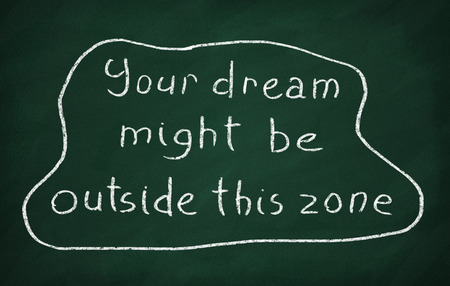 might: On the blackboard with chalk write text: Your dream might be outside this zone Stock Photo