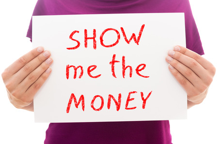 Girl holding white paper sheet with text Show me the money Stock Photo