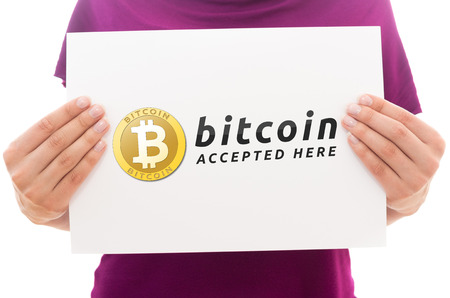 Girl holding white paper sheet with Bitcoin logo