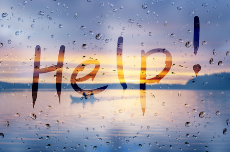the help: Rain on glass with Help text Stock Photo