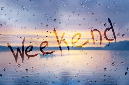 rain: Rain on glass with Weekend text