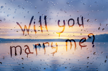 rain wet: Rain on glass with Will you marry me? text
