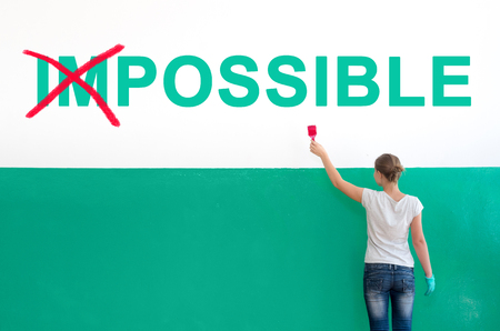 paint: On the white wall with paint write Impossible
