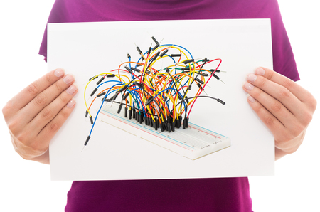 breadboard: Girl holding white paper sheet with Photo of Breadboard