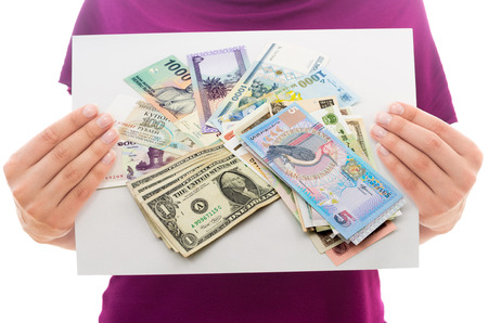 global currencies: Girl holding white paper sheet with Photo of money