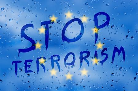 terrorism: Rain on glass with Stop terrorism text Stock Photo