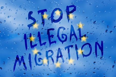 illegal: Rain on glass with Stop illegal migration text