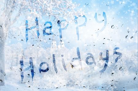winter season: Rain on glass with Happy holidays text
