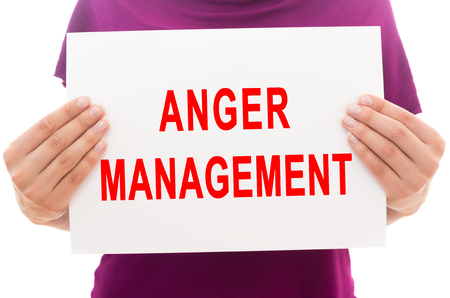 anger management: Girl holding white paper sheet with text Anger management
