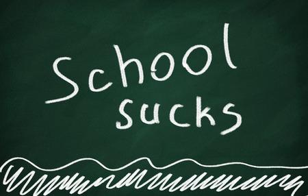 sucks: On the blackboard with chalk write School sucks