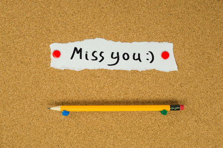 Miss you text note message pin on bulletin board
